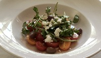 Salade de pastèque et tomates cerises au vinaigre balsamique blanc et huile d'olive extra-vierge