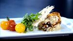 Risotto aux champignons sauvages, croquants de parmesan, jeunes feuilles de roquette et tomates confites à l'huile de basilic